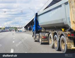 Big Dump Truck Goes Evening On Stock Photo 734596276 - Shutterstock Massive 60 Ton Dump Truck Beds Youtube The Worlds Biggest Dump Truck Top Gear What The Largest Can Tell Us About Physics Of Large Playset Plan 250ft Wood For Kids Pauls Gold Ming Stock Photo Picture And Royalty Free Pit Mine 514340665 Shutterstock Trucks Transporting Platinum Ore Processing Tarps Kits With For Sale In Houston Texas Or Mega 24 Tons Loading Commercial One 14 Inch Rc Mercedes Benz Heavy Cstruction Hoist Parts Together Kenworth W900 Also D Stock Footage Bird View Large Working In A Quarry
