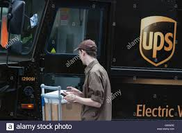 UPS United Parcel Service Logistics Company, Delivery, Electric ... 18 Secrets Of Ups Drivers Mental Floss The Truck Is Adult Version Of Ice Cream Mirror Front Center Roy Oki Has Driven The Short Route To A Long Career Truck And Driver Unloading It Mhattan New York City Usa Plans Hire 1100 In Kc Area The Kansas Star Brussels July 30 Truck Driver Delivers Packages On July Stock Picture I4142529 At Featurepics Electric Design Helps Awareness Safety Quartz Real Fedex Package Van Skins Mod American Simulator Exclusive Group Formed As Wait Times Escalate Cn Ups Requirements Best Image Kusaboshicom By Tricycle Portland Fortune