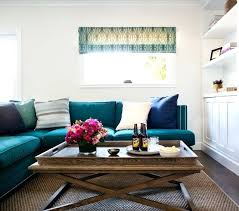 Brown And Teal Living Room Designs by Teal Couch Living Room Example Of A Trendy Dark Wood Floor Living