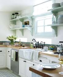 Country Kitchen With Raised Panel Large Ceramic Tile Inset Cabinets Moen Waterhill Wrought