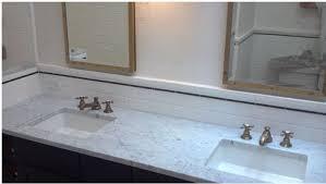 and simple tile backsplash pencil ties in with black vanity