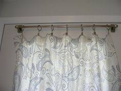magnetic curtain rods used to hold artwork on metal door for the