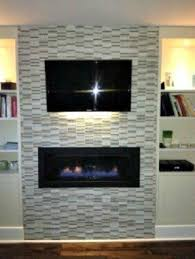 Glass Mosaic Tiled Fireplace Surround With Wall Mounted Tv