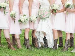 Bridal Party Boot Photo Showcasing Soft Pink Dresses And Hydrangea Babys Breath Bridesmaid Bouquets