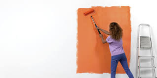 How To Paint A Wall Using With Roller Technique Woman Demonstrating Orange