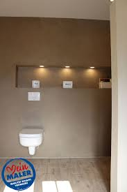 modernes bad mit kalkputz und fugenlosen duschwänden vom