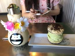 the milk tea with boba in a flower crown lightbulb cup