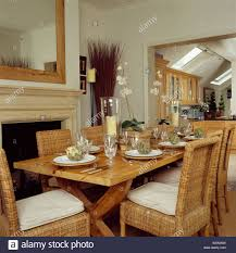 Wicker Chairs And Simple Wood Table In Cream Dining Room ...