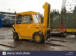 Lift Truck Stock Photos & Lift Truck Stock Images - Alamy Industrial Truck Scales In Montana For Sale Dumper Isolated Stock Image Of Coal Loader Crown Equipment Cporation Usa Material Handling Industrial Trucks Benefit From Motion Plastics Industry Update Deere 486e Big Wheel Lift Sold John Trucks Safety Traing Class 1 4 5 Ooshew Yellow On Photo Edit Now Photos Images Alamy New Road Cstruction Earthworks Landscape Side View Of Color Designed For Infinity