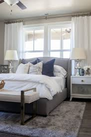 Alice Lane Home Collection Daybreak Lake Loft Gray Upholstered Bed In Master Bedroom White Bedding And Neutral Decor Lindsay Salazar Photography