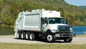 Heil PowerTrak Commercial PLUS Rear Load Garbage Truck | Heil