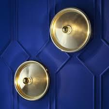 spun wall light brass by tom dixon