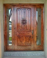 Tuscan Style Entrance Door Knotty Alder Wood With Wrought Iron This