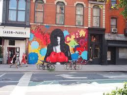 joe and tim barber at joe strummer mural near jesse malins bar
