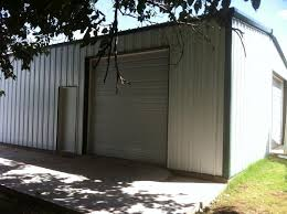 Backyard Shop with Overhead Doors