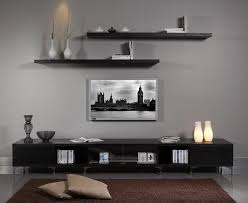 Two Shelves Above Tv Decorative Items Beside