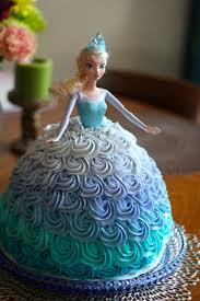 Disney s Frozen Elsa doll cake made with an Ombre Rosette skirt for a Frozen birthday party