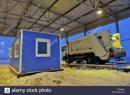 Murmansk Region, Russia. 27th Dec, 2017. A Garbage Truck At An Stock ...