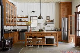 Wooden Island And Round Stools Completing Vintage Kitchen Decorating Ideas With Black Granite Countertop