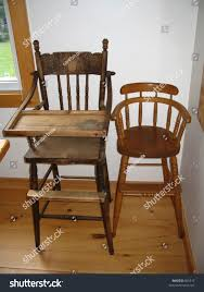 Antique Highchairs | Royalty-Free Stock Image Old Wooden High Chair Facingwalls Antique Reproduction Ash Wood Ding Table With Italian American Style Fniture Sofa Chairantique Luxury Real Leather Throne Sofaclassic Hand Carved Wood Bf01xy1008 Buy Classic Frame Cushion For Vintage Chairs Custom 1900 Heirloom Baby Solid Oak Past Projects Rjh Collection American Iron Bar Stool High Chair Backrest Contracted To Do Awesome Picture Of Kitchen Ding Room Image Bentwood Lattice Highchair Teak And Chairs Tables Red