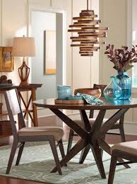A Modern Chandelier Hangs Over Dining Room Table
