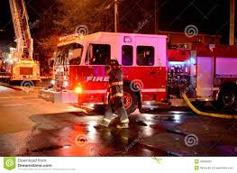 Fire Truck At The Scene Of A Fire. Stock Image - Image Of ...