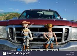 A Woody And Jessie Doll From Toy Story Attached To A Car Grill In ... Toy Story Pizza Planet Blazer Truck Replace Gta5modscom Toy Story Imaginext Pizza Planet Truck With Woody Disney Pixar Video Slinky Dog Character From Pixarplanetfr 3 Talking Lotso Bear Garbage 13 Disney Pixar Takara Tomy Tomica 4904810869672 In Co 402 A Truck Drives By Lotsos Dump Lego Set 7789 Monster Buzz Lightyear Amazoncom Fisherprice Shake N Go Disneypixar Of Terror Easter Eggs The Good