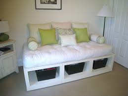 diy white platform daybed with open storage underneath for basket