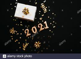 Items Where Year Is 2021 Gold Numbers 2021 And Next To Them Items On A Black