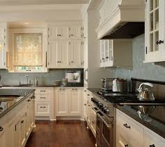 Perfect Kitchen Color Scheme Dark Granite And Cream Cabinets With Light Blue Subway Tile