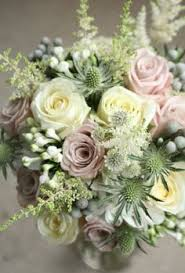 A shabby chic bridal bouquet featuring succulents dusty pink roses