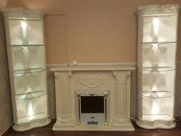 medusa wohnwand säulenvitrinen kamin griechisch barock regal wohnzimmer