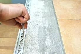 ceramic tile molding securing metal tile edging with screws
