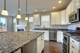 pretty white kitchen cabinets with brown granite countertops