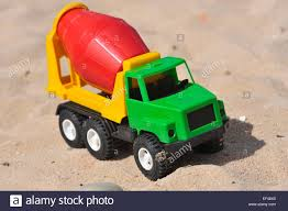Child's Toy Cement Truck On A Sandy Beach In Summer Stock Photo ... Bruder Mack Toy Cement Truck Yellow Cement Mixer Truck Toy Isolated On White Background Building 116th Bruder Scania Mixer The Cheapest Price Kdw 1 50 Scale Diecast Vehicle Tabu Toys World Blue Plastic Mixerfriction 116 Man Tgs Br03710 Hearns Hobbies Melbourne Australia Red Big Farm Peterbilt 367 With Rseries Mb Arocs 3654 Learning Journey On Go Kids Hand Painted Red Concrete Coin Bank Childs A Sandy Beach In Summer Stock Photo
