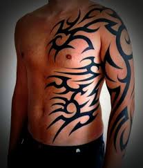 Man With Tribal Tattoo On Full Sleeve And Side Rib