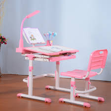 cute pink white height adjustable desk for children together