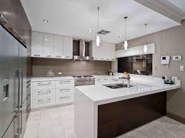 Kitchen U Shaped With Breakfast Bar Mosaic Tile Backsplash Behind Cooktop Faucet Pendant Lamp Blue Storage