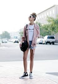 Denim Shorts A White Tee Pink Jacket And High Top Sneakers