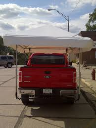 Tailgate Canopy | Genesis Enterprises How To Choose A Commercial Truck Cap For Your Vehicle Dimeions Of Carport Metal Carport Suv Truck Modern Big Rigs White Semi Trucks Are At A Filling Station With Canopy Lift Youtube Hard Bed Cover Great Wall Wingle 5 Pickup Shop 2011 Ram 1500 Quad Cab Power Rear Window Aux Port Paint Matching Caps Custom Al Are Fiberglass World Amazoncom Bestop 7630435 Black Diamond Supertop Bed Tool Inspirational Fniture New Gladiator Pickup Truck Bed Tent Camping Outdoor Canopy Camper