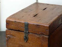 I love antique or at least antique looking wooden boxes to store