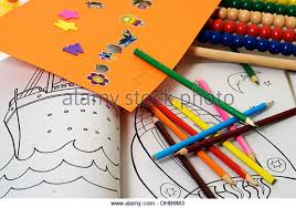 Close Up Of Childrens Colouring Book And Pencils Other Educational Toys