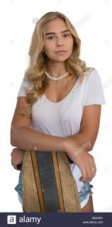 beautiful blond wearing white shirt and jean shorts leaning
