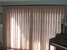 pinch pleat drape on a sliding glass door with a decorative