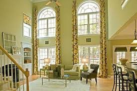 A Typical Living Room Depicting Detailed Interior Decor Complete With Intricate Drapery Perfect For Long Windows