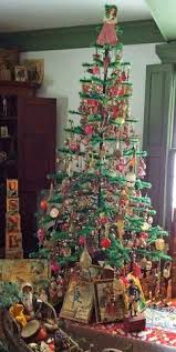 A Feather Tree Decorated With Antique Glass Christmas Ornaments Wonderful Toys Under The Too