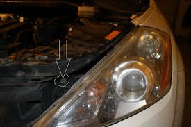 how to get to the headlight housing to replace bulbs nissan