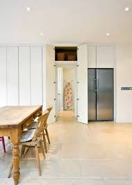 White Trimmed Dining Room With The Hidden Door