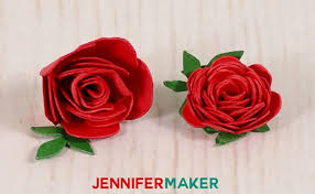 Closeup Of Two Miniature Paper Roses Made With Red And Green Cardstock
