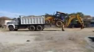 100 Dump Trucks Videos VIDEO Operator Loads Backhoe Into A Dump Truck Without A Ramp